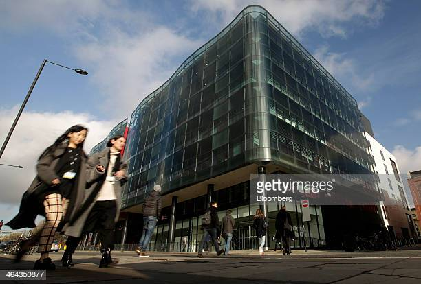 Pedestrians pass the Kings Place office development which houses the editorial offices of the Guardian and Observer newspapers in London UK on...