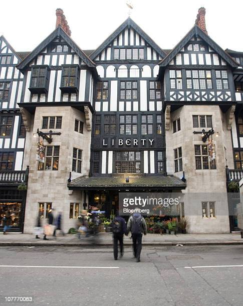 Pedestrians pass the Liberty Co department store in London UK on Thursday Dec 23 2010 UK economic growth slowed more than initially estimated in the...