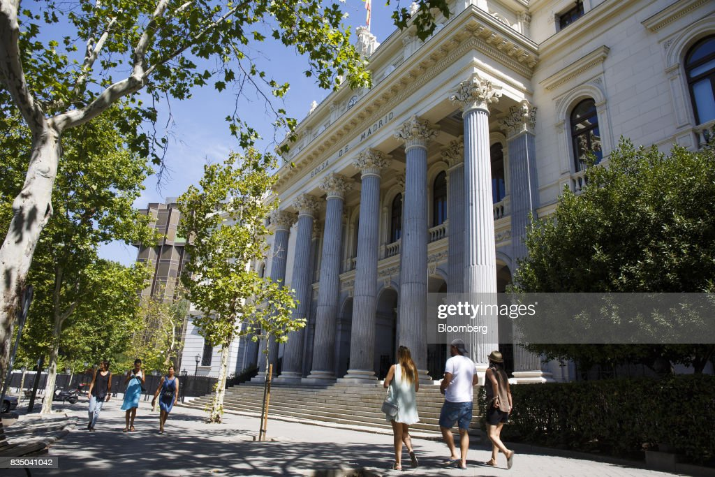 Pedestrians pass the Madrid stock exchange, also known as Bolsas y Mercados Espanoles, the day after the Barcelona terror attack in Madrid, Spain, on Friday, Aug. 18, 2017. Terrorists behind the Barcelona attack had planned a devastating assault with explosives and may have rammed pedestrians with vehicles after their initial plan failed, the police chief heading the investigation said on Friday. Photographer: Angel Navarrete/Bloomberg via Getty Images