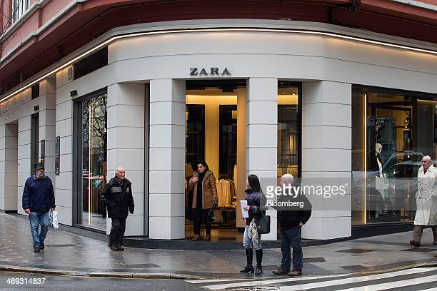 Pedestrians pass the original Zara fashion store operated by Inditex SA which opened in 1975 in La Coruna Spain on Thursday Feb 13 2014 Inditex which...