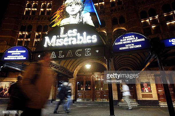 Pedestrians pass the Palace Theatre in Shaftsbury Avenue London Sunday March 7 2004 London's theaters home to productions such as ``Les Miserables''...