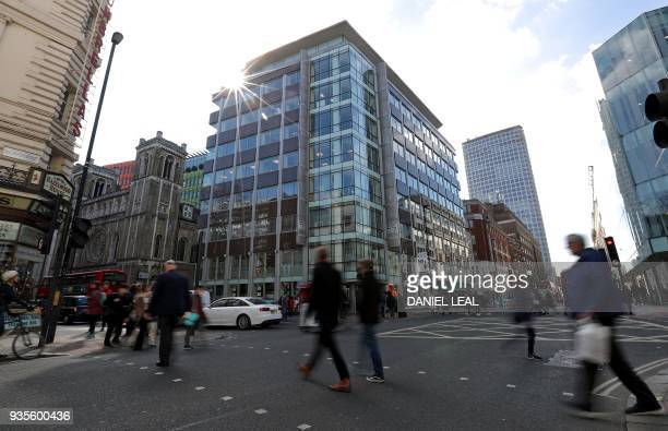 pedestrians pass the shared building which houses the offices of Cambridge Analytica in central London on March 21 2018 Facebook expressed outrage...