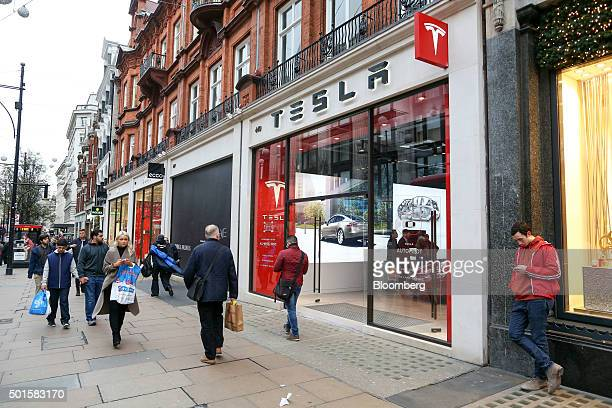 Pedestrians pass the Tesla Motors Inc showroom at a dealership on Oxford Street in London UK on Wednesday Dec 16 2015 After losing $188 billion since...
