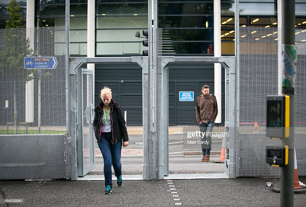 Pedestrians pass through a gate in the security fence that has been erected around the Royal Welsh College of Music and Drama ahead of the Nato Summit 2014 that is being held in South Wales next week on August 26, 2014 in Cardiff, Wales. The barriers have been erected in the Welsh capital as a security measure as preparations for the international conference continue at the Celtic Manor Resort in Newport.
