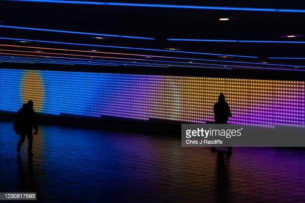 Pedestrians pass through a road underpass close to a Covid-19 vaccination centre near Wembley Stadium on January 27, 2021 in London, United Kingdom....