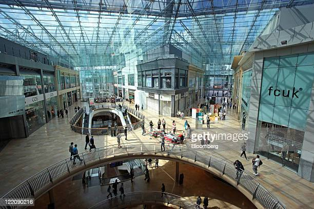 Pedestrians pass through the Bullring shopping center operated by Hammerson Plc in Birmingham UK on Thursday Aug 25 2011 Hammerson Plc owned 53...