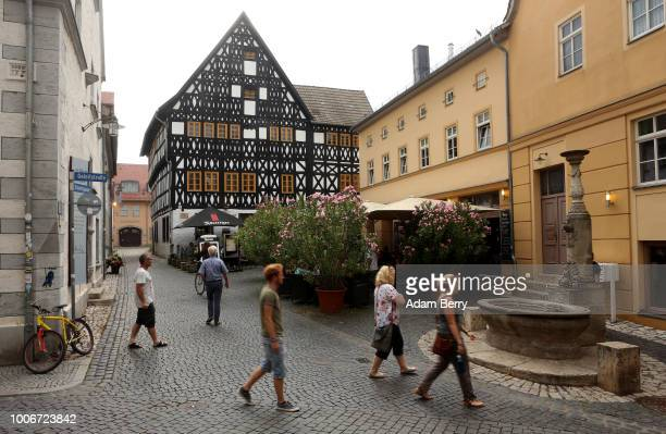 Pedestrians pass through the town during Yiddish Summer Weimar on July 27 2018 in Weimar Germany The annual fiveweek summer institute and festival...