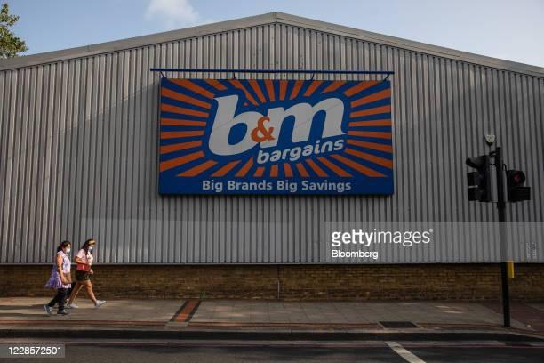 Pedestrians passes a B&M Bargains store, operated by B&M European Value Retail SA, in London, U.K., on Thursday, Sep. 17, 2020. U.K. Retail sales...