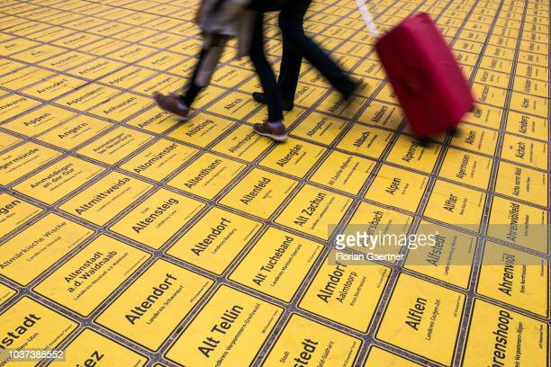 Pedestrians passing a square of about 11400 town signs of all municipalities in Germany on September 21 2018 in Berlin Germany On occasion of the...