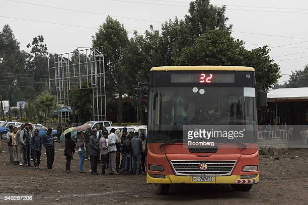 Pedestrians queue for a bus in Addis Ababa Ethiopia on Friday June 24 2016 Kenya and Ethiopia have agreed to build a railway line connecting the...