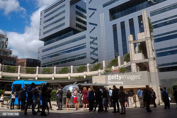 Pedestrians queue for lunch in view of No 5 Broadgate an office complex to be occupied by UBS AG as construction work nears completion in London UK...
