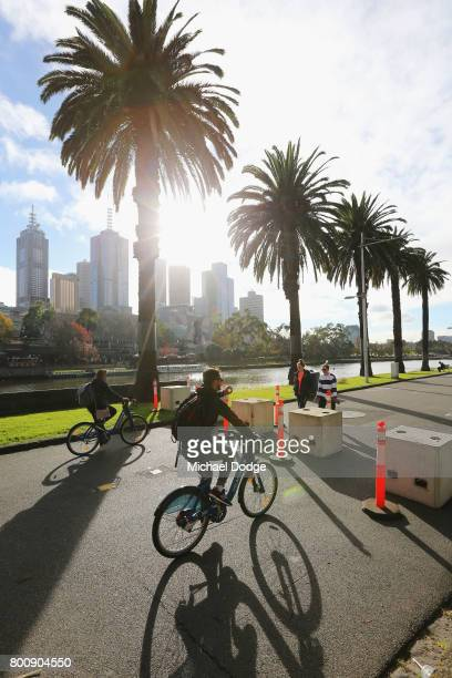 Pedestrians ride along the yarra at the boat sheds between concrete blocks on June 26 2017 in Melbourne Australia The large concrete blocks have been...