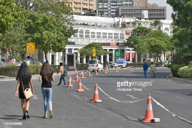 Pedestrians seen at Connaught Place, on June 30, 2019 in New Delhi, India. The New Delhi Municipal Council on Sunday starts its trial run to regulate...