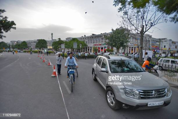 Pedestrians seen at inner circle of the Connaught Place , on June 30, 2019 in New Delhi, India. The New Delhi Municipal Council on Sunday starts its...
