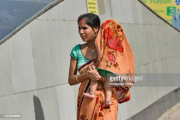 Pedestrians seen at inner circle of the Connaught Place, on June 30, 2019 in New Delhi, India. The New Delhi Municipal Council on Sunday starts its...