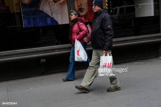 Pedestrians shop in the Herald Square neighborhood of Manhattan April 11 2018 in New York City US consumer prices rose 24 percent in March from a...