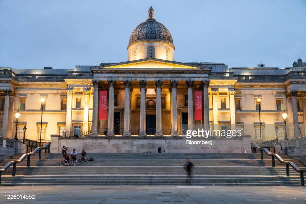 Pedestrians sit on the steps outside The National Gallery in Trafalgar Square, London, U.K., on Thursday, July 9, 2020. The U.K. Will plow 1.6...