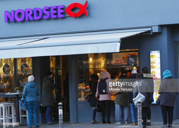 Pedestrians stand by a Nordsee fish restaurant on January 8 2018 in Berlin Germany According to government statisticians nominal revenue grew...