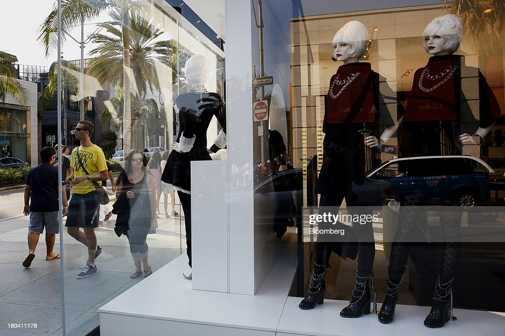 Pedestrians stand in front of mannequin displayed in the window of a Chanel store on Rodeo Drive in Beverly Hills, California, U.S., on Wednesday, Sept. 11, 2013. The U.S. Census Bureau is scheduled to release retail sales figures on Sept. 13. Photographer: Patrick T. Fallon/Bloomberg via Getty Images