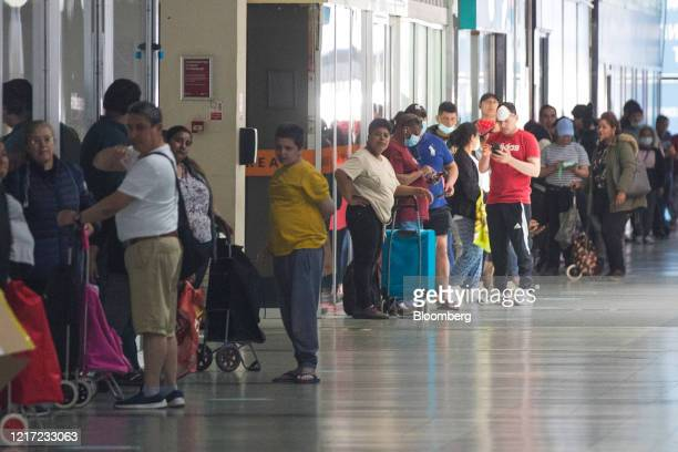 Pedestrians stand in line to collect food parcels from the food bank run by Dads House charity in London, U.K., on Tuesday, June 2, 2020. Bolstering...
