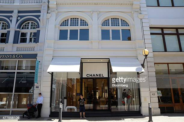 Pedestrians stand outside a Chanel SA store on King Street in Perth Australia on Thursday March 6 2014 The Western Australia state government said in...