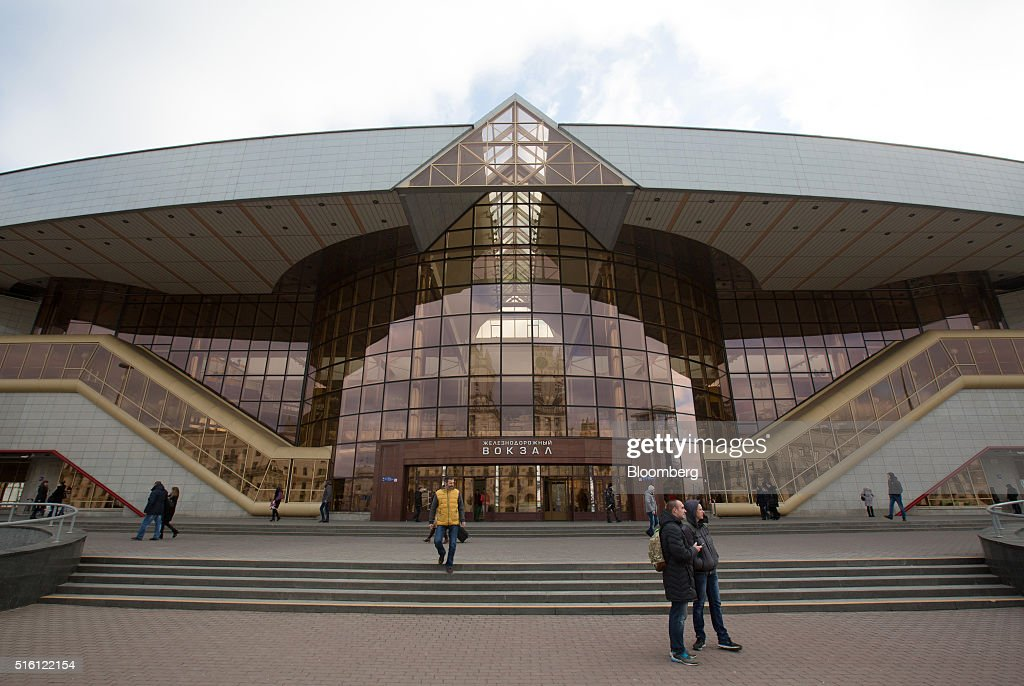 Pedestrians stand outside the Minsk railway station, also known as Minsk-Passazhirsky, in Minsk, Belarus, on Wednesday, March 16, 2016. European Union governments scrapped sanctions on leaders of Belarus in an effort to pry the former Soviet republic out of the shadow of the Kremlin. Photographer: Andrey Rudakov/Bloomberg via Getty Images
