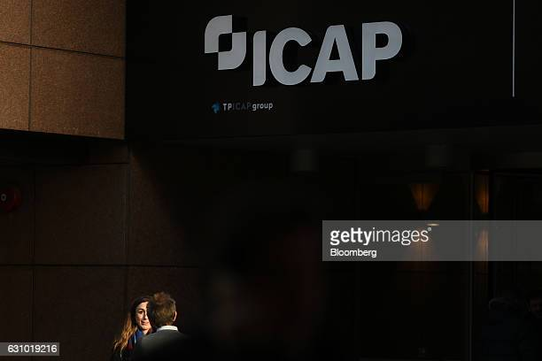 Pedestrians stand outside the TP ICAP Plc and NEX Group Plc offices on Broadgate Circle in London UK on Thursday Jan 5 2017 Tullett Prebon Plc...