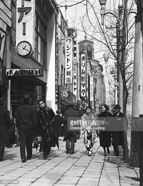 Pedestrians strolling down shopping street in Ginza district