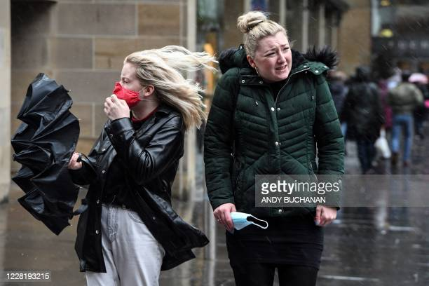Pedestrians struggle against the wind in Glasgow city centre on August 25 as Storm Francis brings rain and high winds to the UK.