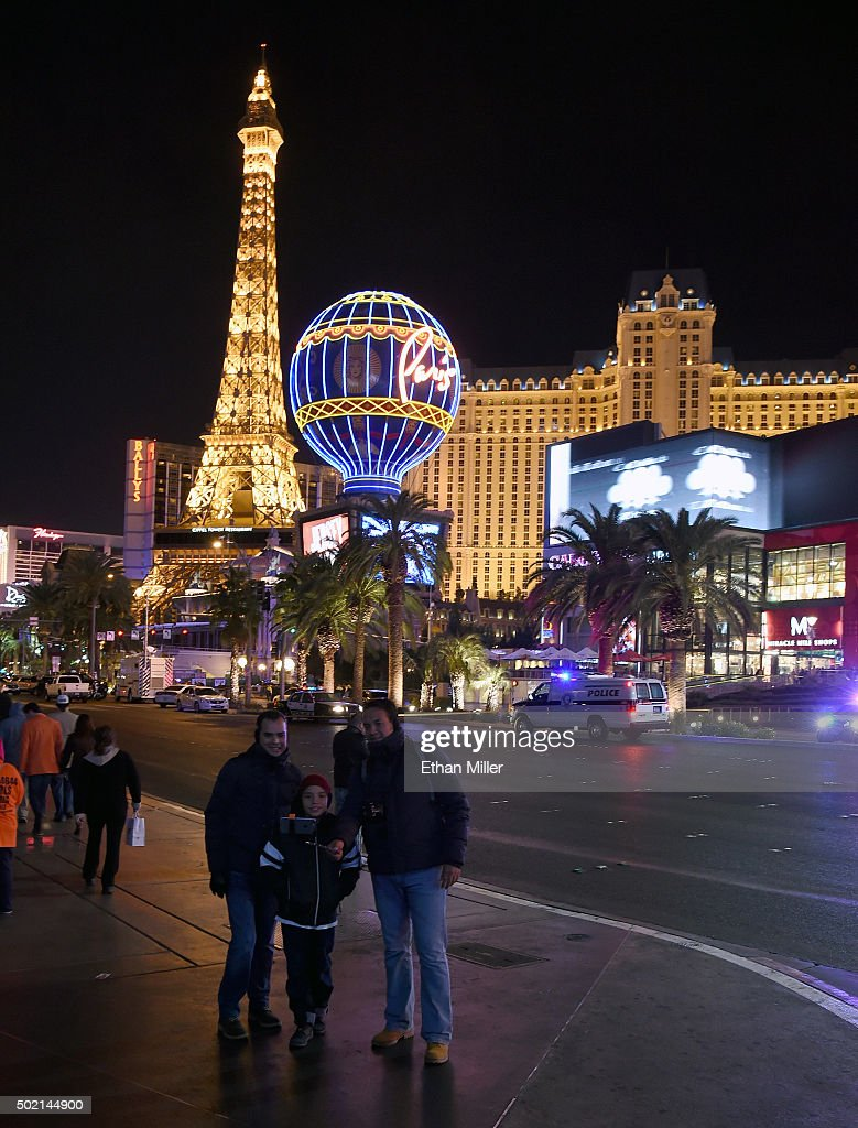 Pedestrians take a selfie across the street from the Paris Las Vegas after police shut down vehicle traffic on the Las Vegas Strip after a car crashed into a group of pedestrians on the sidewalk in front of the Paris Las Vegas and Planet Hollywood Resort & Casino reportedly injuring at least 35 people and killing one on December 20, 2015 in Las Vegas, Nevada.