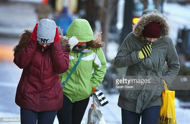 Pedestrians try to keep warm as they walk through downtown in belowzero temperature January 27 2014 in Chicago Illinois The city is bracing for...