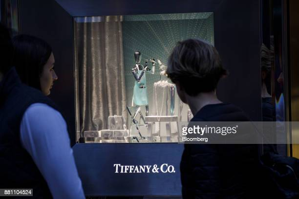 Pedestrians view a holiday window display at the Tiffany Co store on Rodeo Drive in Beverly Hills California US on Sunday Nov 26 2017 Tiffany Co is...