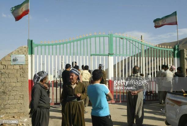Pedestrians wait by the closed gates on the Iraqi side of the IraqIran border crossing of Haj Omran in the Iraqi Kurdistan 07 October September 2007...