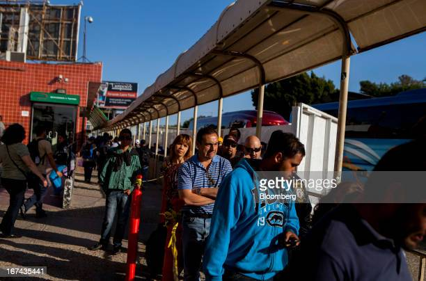 Pedestrians wait in line to cross the border into the US at the San Ysidro Port of Entry in Tijuana Mexico on Monday April 22 2013 The Obama...
