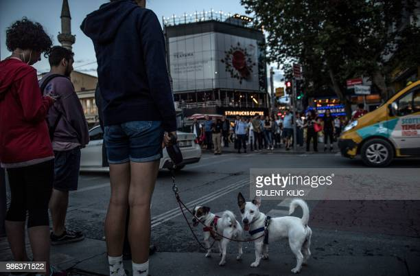 pedestrians wait to cross the road at Kadikoy in Istanbul on June 28 2018