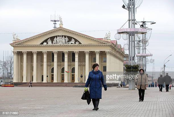 Pedestrians walk across a city square past the Minsk Trade Union Palace of Culture in Minsk Belarus on Wednesday March 16 2016 European Union...