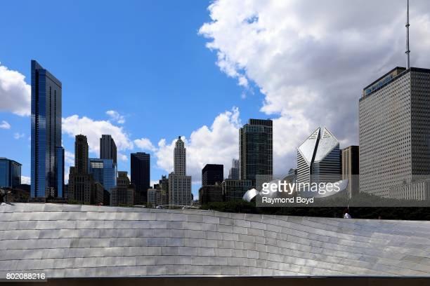 Pedestrians walk across Frank Gehry's 'BP Pedestrian Bridge' over to Millennium Park in Chicago Illinois on June 24 2017