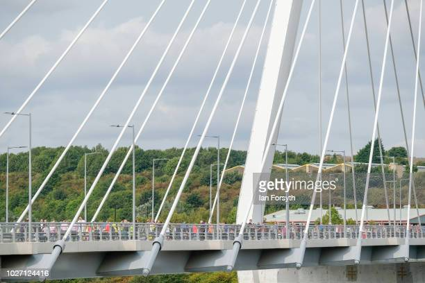 Pedestrians walk across the new Northern Spire bridge spanning the River Wear as it opens for a pedestrian walkover on August 28 2018 in Sunderland...