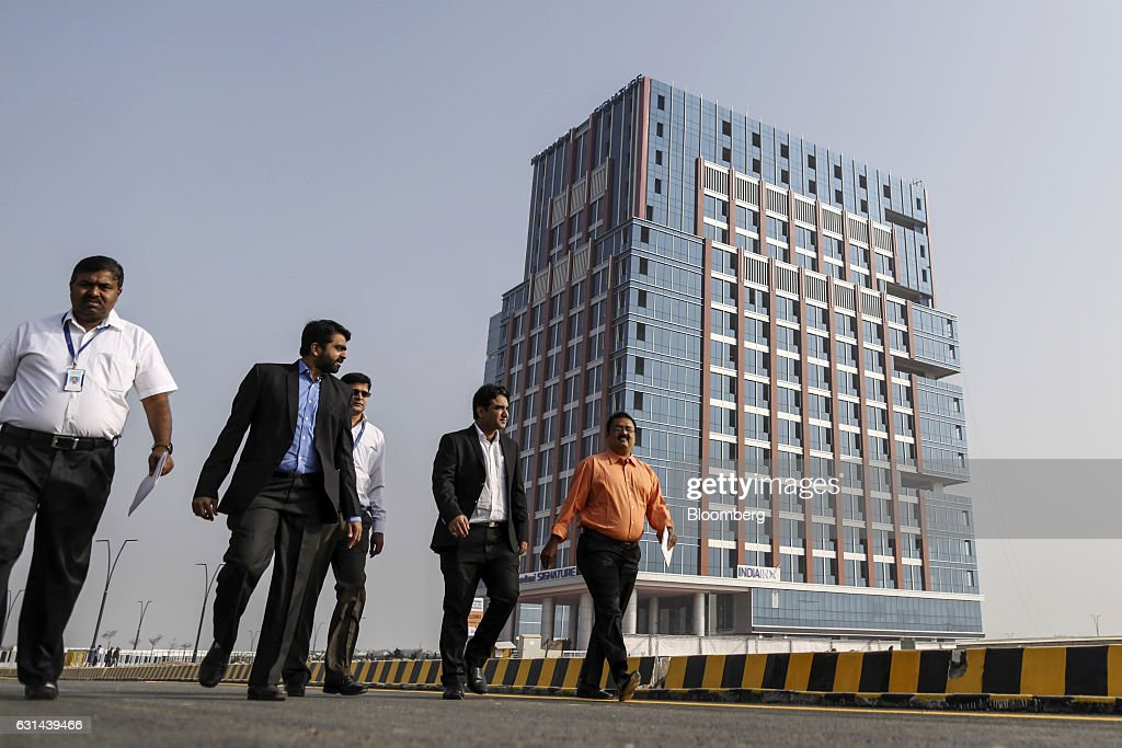 General views of the under construction tec city pedestrians walk along a road near the india international exchange india inx building in negle