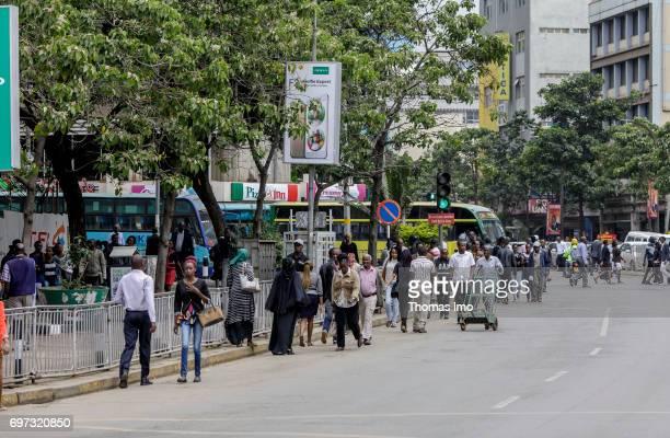 Pedestrians walk along a street Street scene in Nairobi capital of Kenya on May 15 2017 in Nairobi Kenya