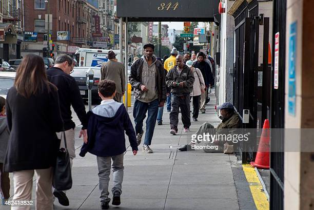 Pedestrians walk along Ellis Street in the Tenderloin district of San Francisco California US on Sunday Jan 18 2015 In a city where wealth has...