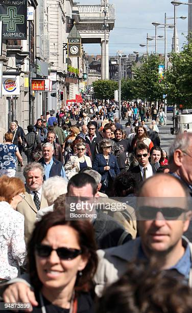 Pedestrians walk along O'Connell Street in Dublin Ireland on Monday July 21 2008 Brian Cowen Ireland's Taoiseach said it will take time for the...