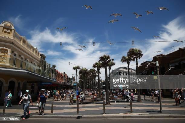 Pedestrians walk along the Manly Corso retail area as seagulls fly overhead in Sydney Australia on Friday Jan 5 2018 The Australian Bureau of...