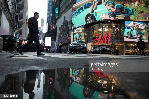 Pedestrians walk along West 42nd Street in the Times Square neighborhood of New York US on Friday March 15 2019 US stocks joined a global advance in...