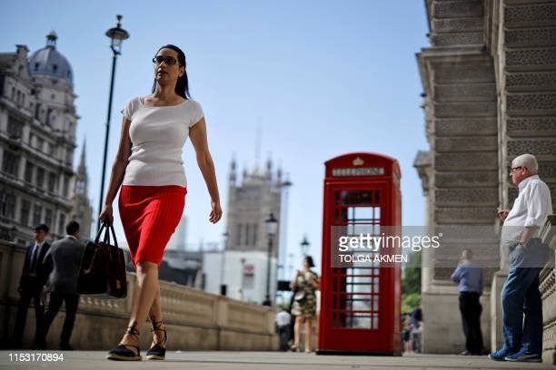 Pedestrians walk along Whitehall near the Houses of Parliament in Westminster central London on July 2 2019 Britain was due to leave the EU on March...