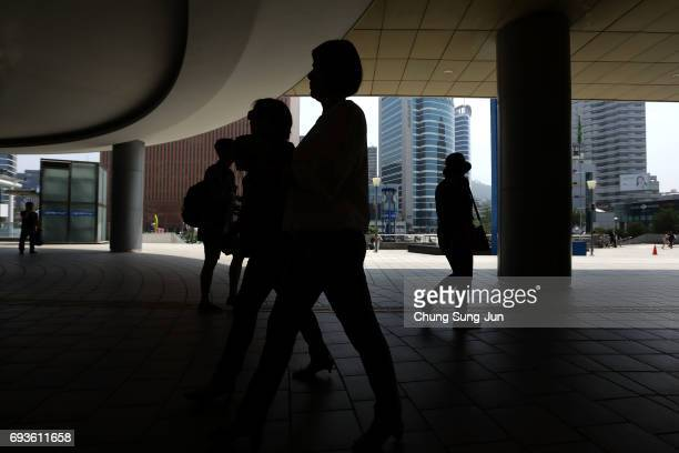 Pedestrians walk at the Seoul Railway Station on June 8 2017 in Seoul South Korea According to the South Korean military North Korea launched several...