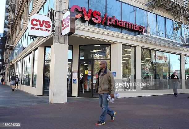 Pedestrians walk by a CVS store on November 5 2013 in San Francisco California CVS Caremark reported a 25 percent surge in thirdquarter earnings with...