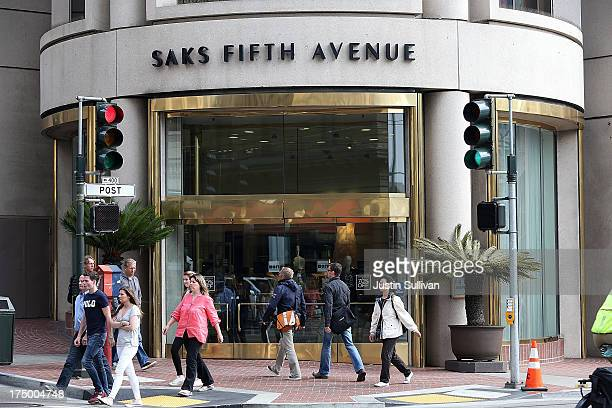 Pedestrians walk by a Saks Fifth Avenue store on July 29 2013 in San Francisco California Hudson's Bay Co the parent company of Lord and Taylor...
