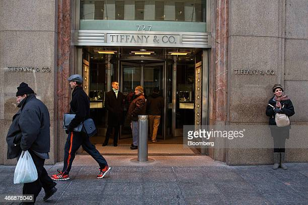 Pedestrians walk by a Tiffany Co store on Fifth Avenue in New York US on Wednesday March 18 2015 Tiffany is scheduled to report fourthquarter...