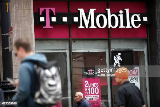 Pedestrians walk by a TMobile store on April 24 2017 in San Francisco California TMobile will report first quarter earnings today after the closing...